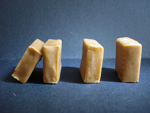 Image of toffees stacked like dominos